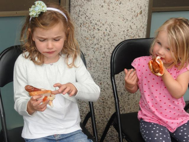 Sisters enjoying a sausage and sauce