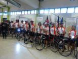 Greeting the cyclists after their week long fundraising ride at the Welcome ceremony